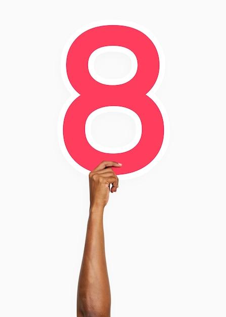 Hand, die zeichen der nr. acht hält Kostenlose Fotos