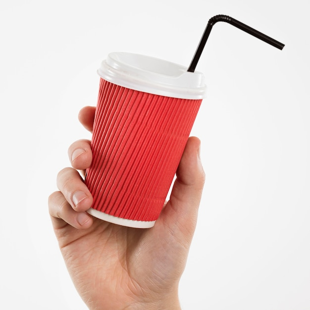 Hand halten tasse mit strohhalm Kostenlose Fotos
