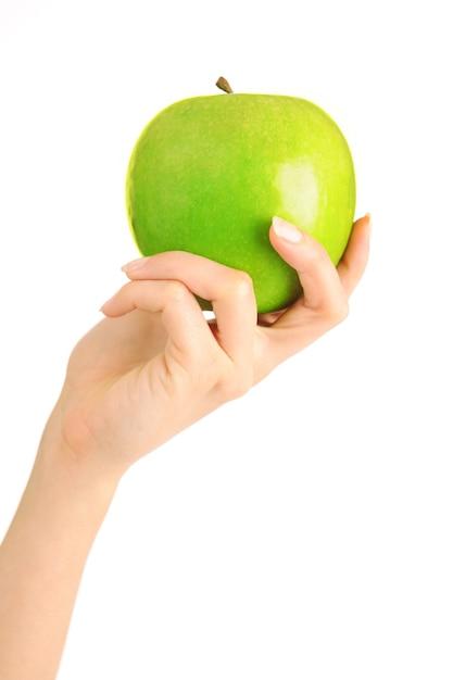 Hand mit apfel lokalisiert auf weißem hintergrund Premium Fotos