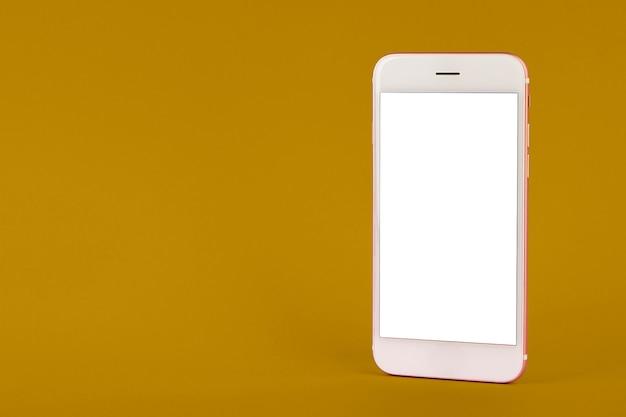 Handy auf gelbem tisch Premium Fotos