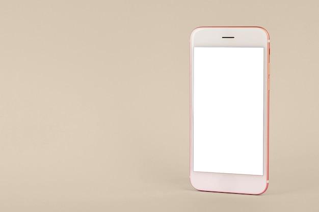 Handy auf rosa tisch Premium Fotos