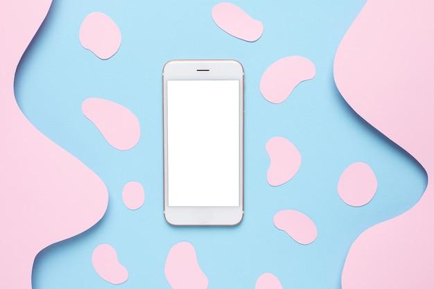 Handy und abstraktes papier schneiden blaue wellenkunst auf rosa Premium Fotos