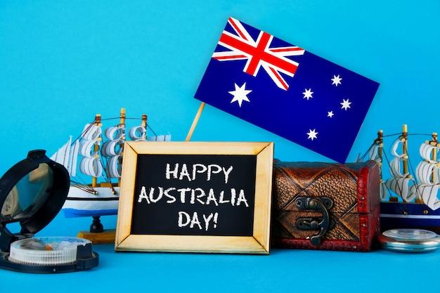 Happy day australia umgeben schiffbauer, kompass, uhr und australische flagge Premium Fotos
