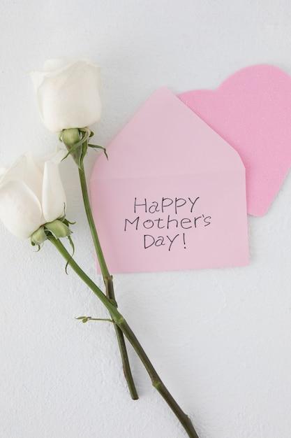 Happy mothers day inschrift mit zwei rosen Kostenlose Fotos
