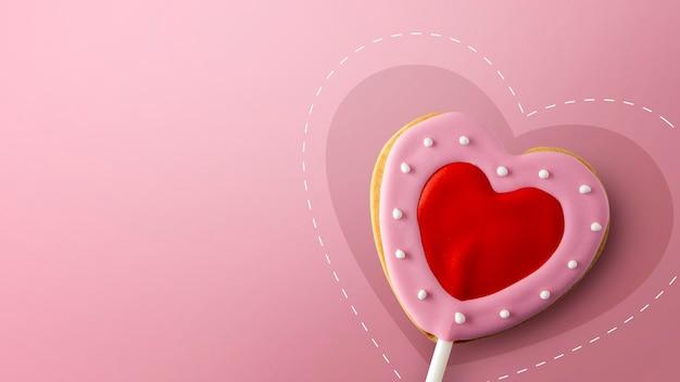 Happy valentinstag konzept. herzförmige kekse auf rosa Premium Fotos