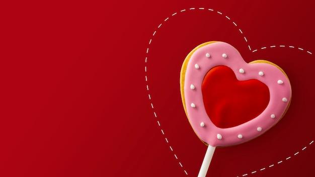 Happy valentinstag konzept. herzförmige kekse auf rot Premium Fotos