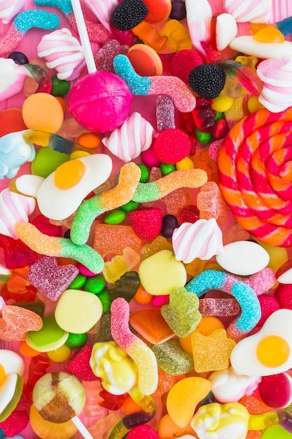 Haufen bunte süßigkeiten Kostenlose Fotos