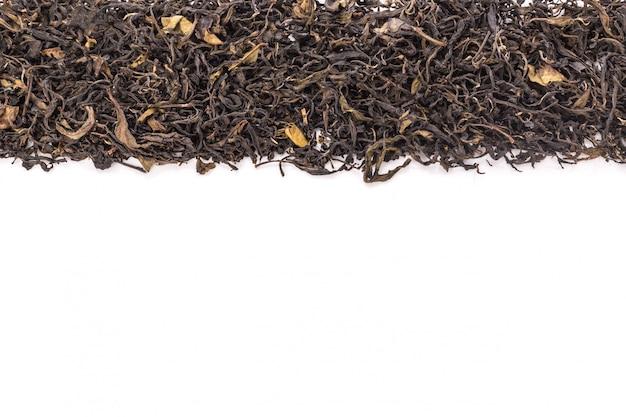 Haufen des getrockneten grünen teeblatts. Premium Fotos