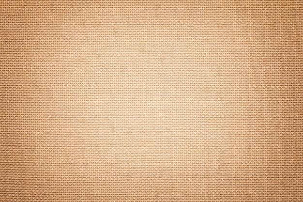 Hellbraun ein textilmaterial mit weidenmuster, nahaufnahme. Premium Fotos