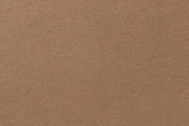 Hellbraune matte veloursledergewebenahaufnahme. velvet textur aus filz. Premium Fotos