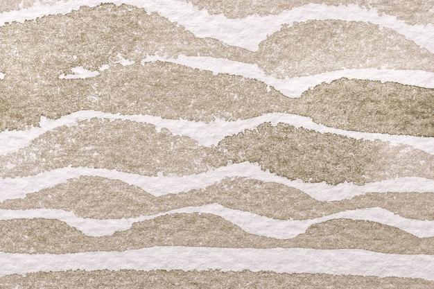 Hellbraune und weiße farben des abstrakten kunsthintergrunds. aquarellmalerei auf leinwand mit beigem wellenmuster. fragment des kunstwerks auf papier mit sandwellenlinie. Premium Fotos
