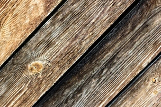 Heller hintergrund von natürlichen braunen hölzernen brettern Premium Fotos