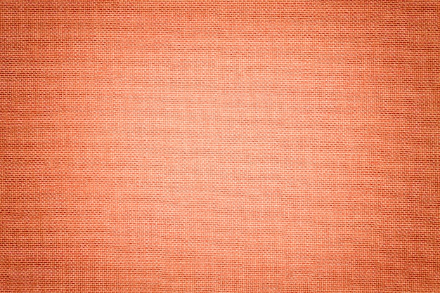 Heller korallenroter hintergrund von einem textilmaterial. Premium Fotos