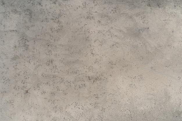 Hellgraue textur mit kleinem fleckmuster. verputzte wand. abstrakter hintergrund. Premium Fotos