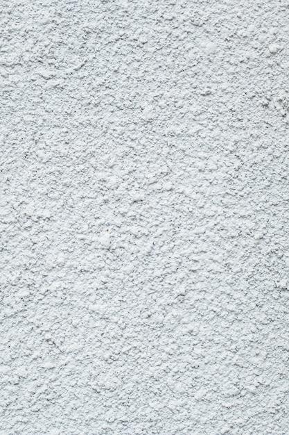 Hellgraue wandbeschaffenheit, stuckhintergrund, schmutzgipsentwurf, abstraktes raues muster. dekoratives element des innenraums, gipsoberfläche, hausfassade. Premium Fotos