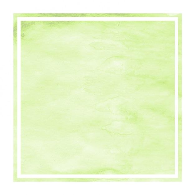 Hellgrüne hand gezeichnete rechteckige rahmen-hintergrundbeschaffenheit des aquarells mit flecken Premium Fotos