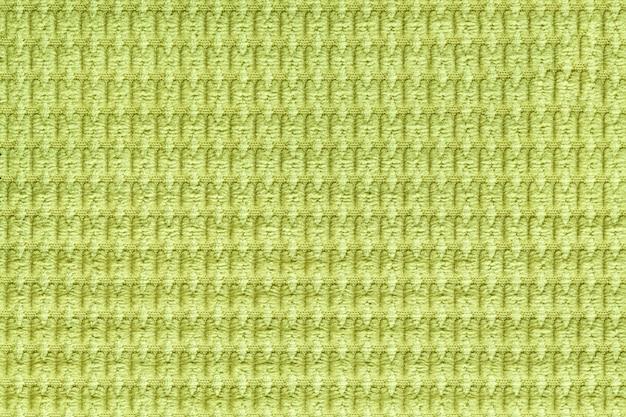 Hellgrüner hintergrund vom weichen flauschigen gewebeabschluß oben. textur von textilien makro Premium Fotos