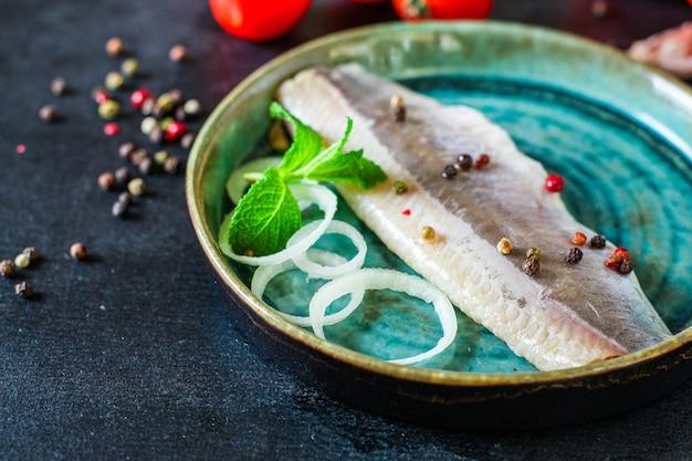 Hering gesalzener fisch meeresfrüchte Premium Fotos