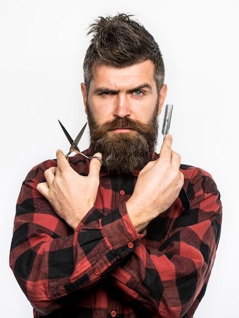 Herren haarschnitt rasieren männchen im friseursalon Premium Fotos