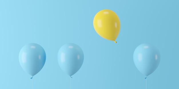 Hervorragender gelber ballon des minimalen konzeptes, der mit blauen ballonen auf blauem hintergrund schwimmt Premium Fotos