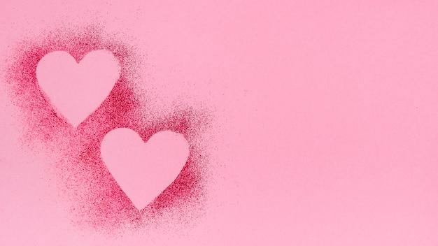 Herzformen aus glitzerpulver Kostenlose Fotos