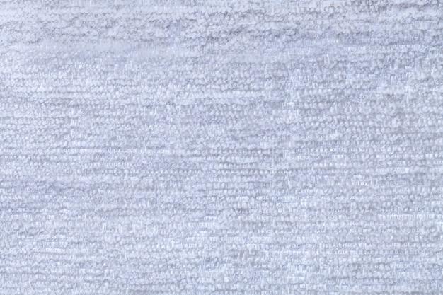Himmelblauer flaumiger hintergrund des weichen, flaumigen stoffes beschaffenheit des hellen windelgewebes, nahaufnahme Premium Fotos