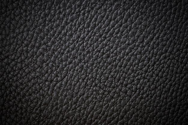 Hintergrund-beschaffenheitsschwarzleder des schwarzen natürlichen ledernen nahaufnahmehintergrundes dunkles Premium Fotos