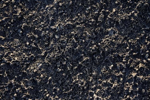 Hintergrund einer schwarzen wand mit interessanten texturen Kostenlose Fotos