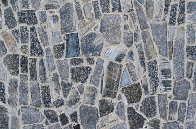 Hintergrund einer steinwand-umhüllungsbeschaffenheit, braune steinziegelsteine Premium Fotos