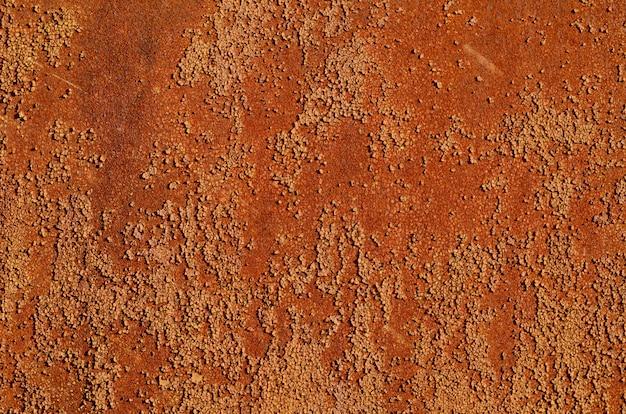 Hintergrund eines rostigen alten eisenblechs, orange und braune farben Premium Fotos