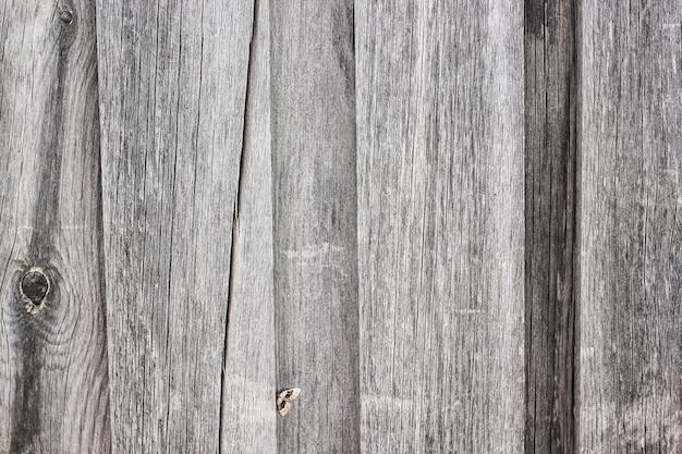 Hintergrund von grauen vertikalen hölzernen brettern Premium Fotos