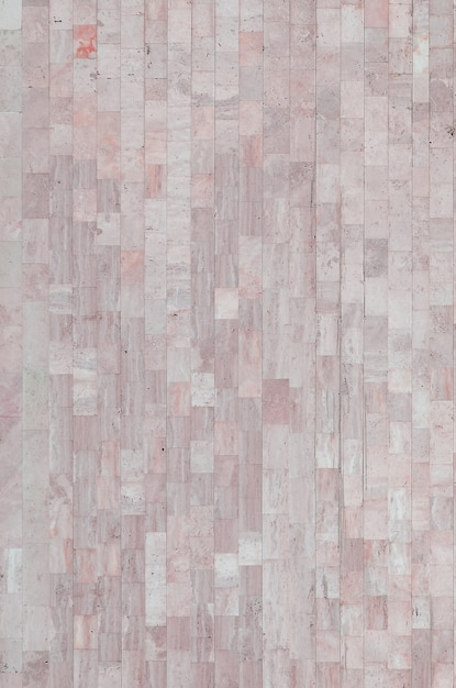 Hintergrundbeschaffenheit der alten beige marmorwand von einer vielzahl von großen fliesen Premium Fotos