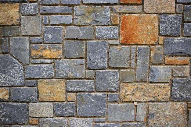 Hintergrundbeschaffenheit der steinmauer Premium Fotos