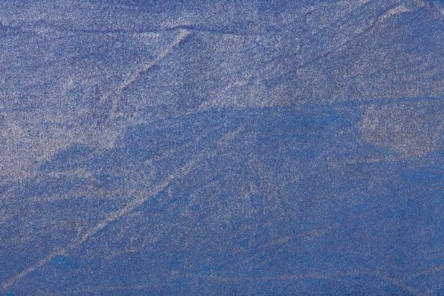 Hintergrundmarineblau der abstrakten kunst und silberne farbe. mehrfarbenmalerei auf segeltuch. Premium Fotos