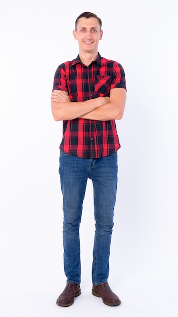 Hipster mann trägt rotes kariertes hemd isoliert gegen