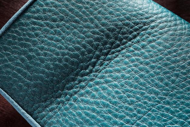 Hochwertiges blaues ledermaterial auf dunklem hintergrund Kostenlose Fotos