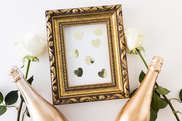 Hochzeitsverzierungen mit champagnerflasche Kostenlose Fotos