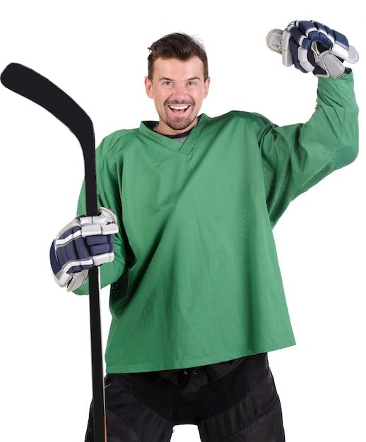 Hockeyspieler feiert seinen sieg mit glücklicher emotion. Premium Fotos