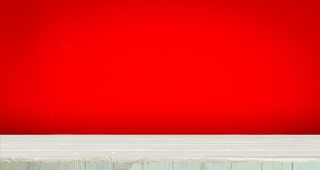 Hölzern mit rotem hintergrund Premium Fotos