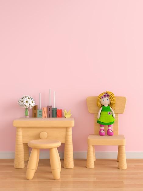 Hölzerne tabelle und stuhl im rosafarbenen kinderraum Premium Fotos