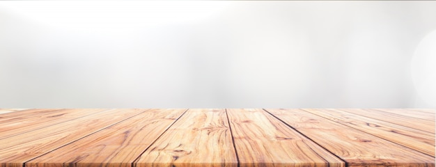 Hölzerne tischplatte des teakholzes auf weißem hintergrund für breiten fahnenhintergrund benutzte uns montageanzeige Premium Fotos