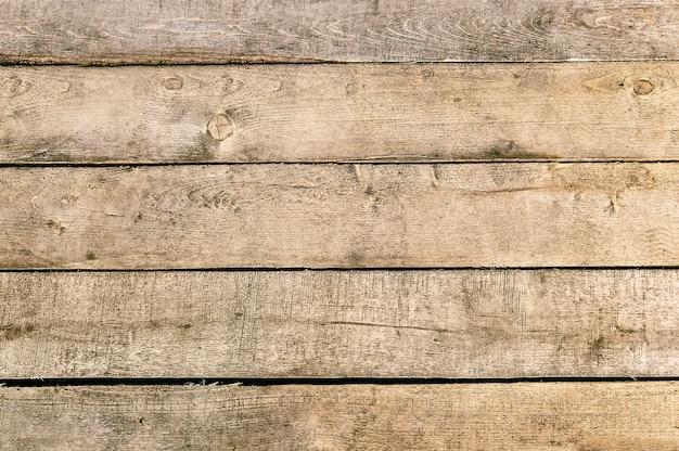 Hölzerner brauner plankenbeschaffenheitshintergrund Premium Fotos