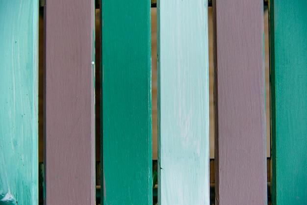 Hölzernes brett gemalter grüner brauner zusammenfassungshintergrund der alten art. Premium Fotos