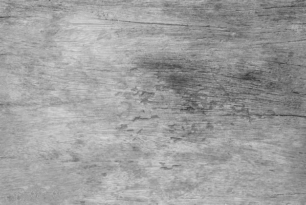 Hölzernes oberflächenmuster der nahaufnahme am alten und hölzernen tabellenbeschaffenheitshintergrund des sprunges im schwarzweiss-ton Premium Fotos