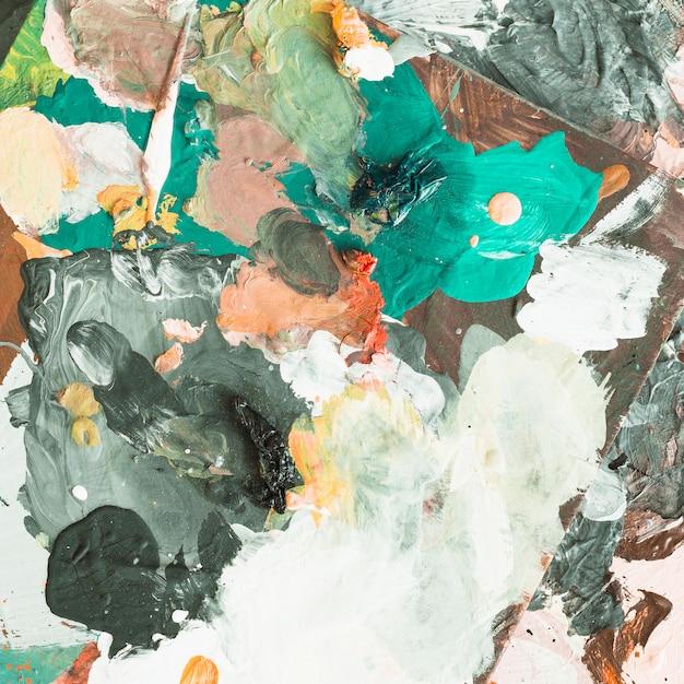 Hohe winkelsicht des unordentlichen künstlerischen malereihintergrundes Kostenlose Fotos
