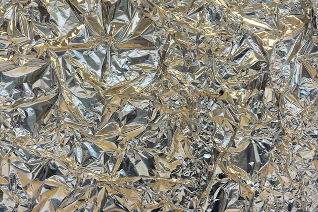 Holographische textur geknitterte metallfolie. Premium Fotos