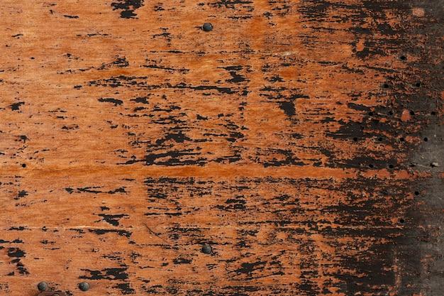 Holz mit abgenutzter oberfläche und löchern Kostenlose Fotos