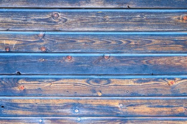 Holzbretter hintergrund. gealterte verbrannte schwarze und blaue holzbretter Premium Fotos