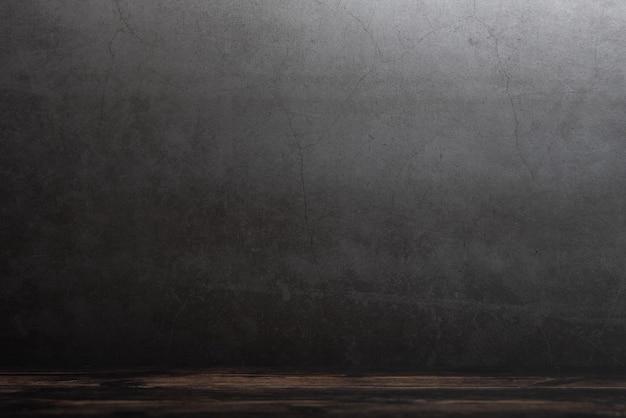 Holzdeckter tisch auf einem grauen schmutzhintergrund Premium Fotos