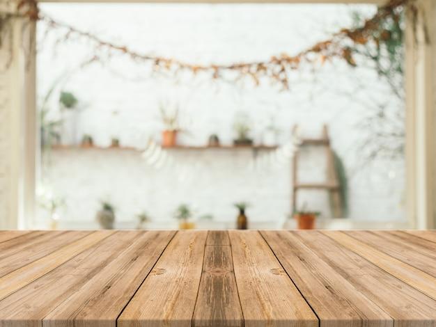 Holztisch mit unscharfen hintergrund Kostenlose Fotos